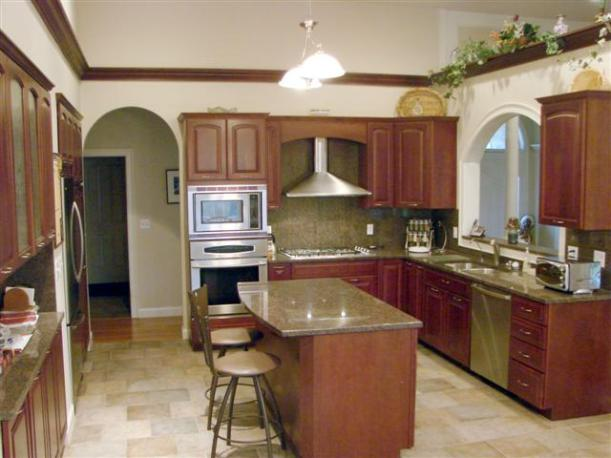 cherry cabinets, staniless steel appliances in Londonderry New Hampshire home for sale